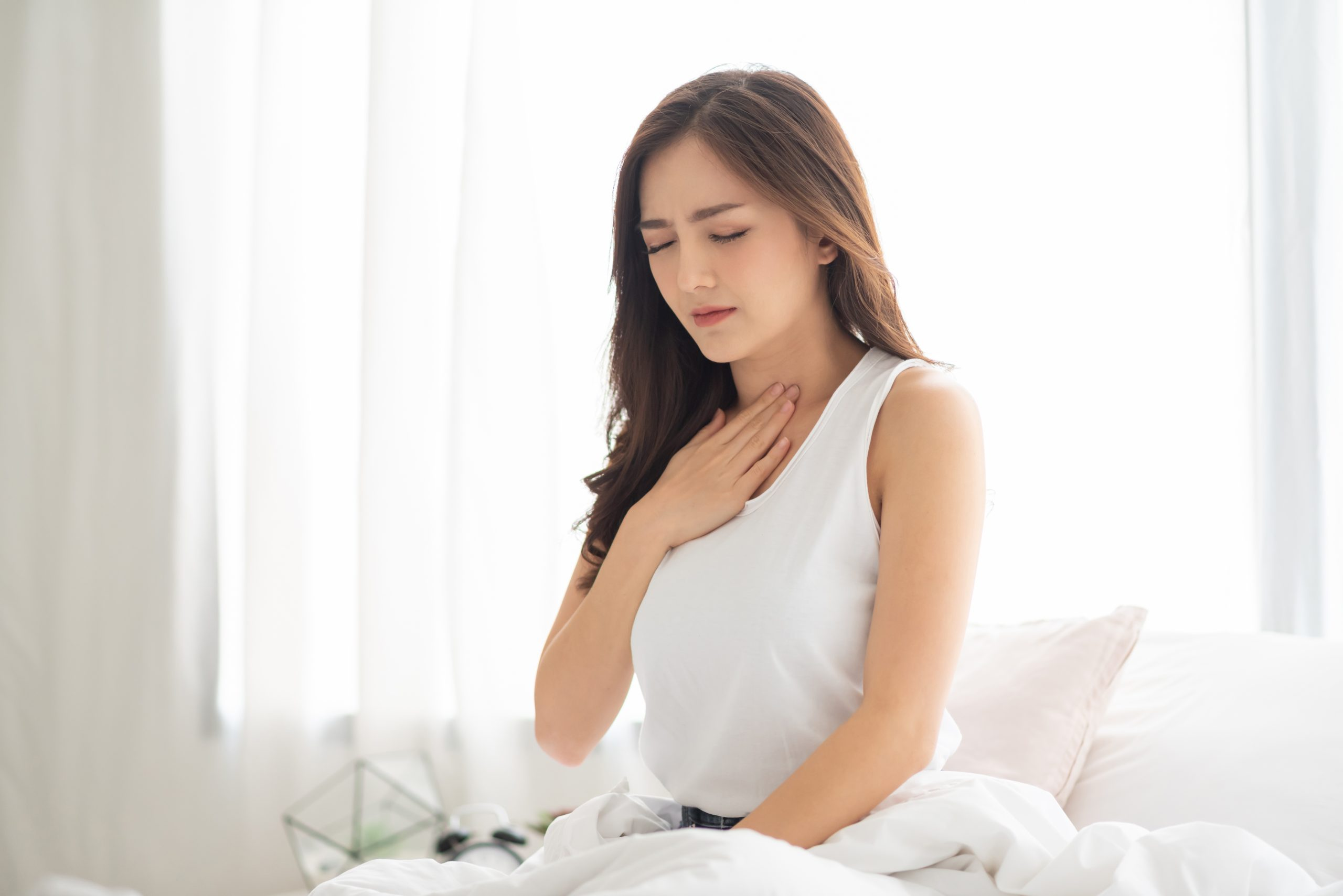 https://nutroo.me/wp-content/uploads/2020/12/asian-beautiful-woman-with-acid-reflux-on-her-bed-illness-disease-symptom-stockpack-istock-scaled.jpg